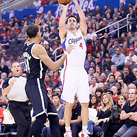 16 November 2013: Los Angeles Clippers shooting guard J.J. Redick (4) takes a jumpshot over Brooklyn Nets point guard Shaun Livingston (14) during the Los Angeles Clippers 110-103 victory over the Brooklyn Nets at the Staples Center, Los Angeles, California, USA.
