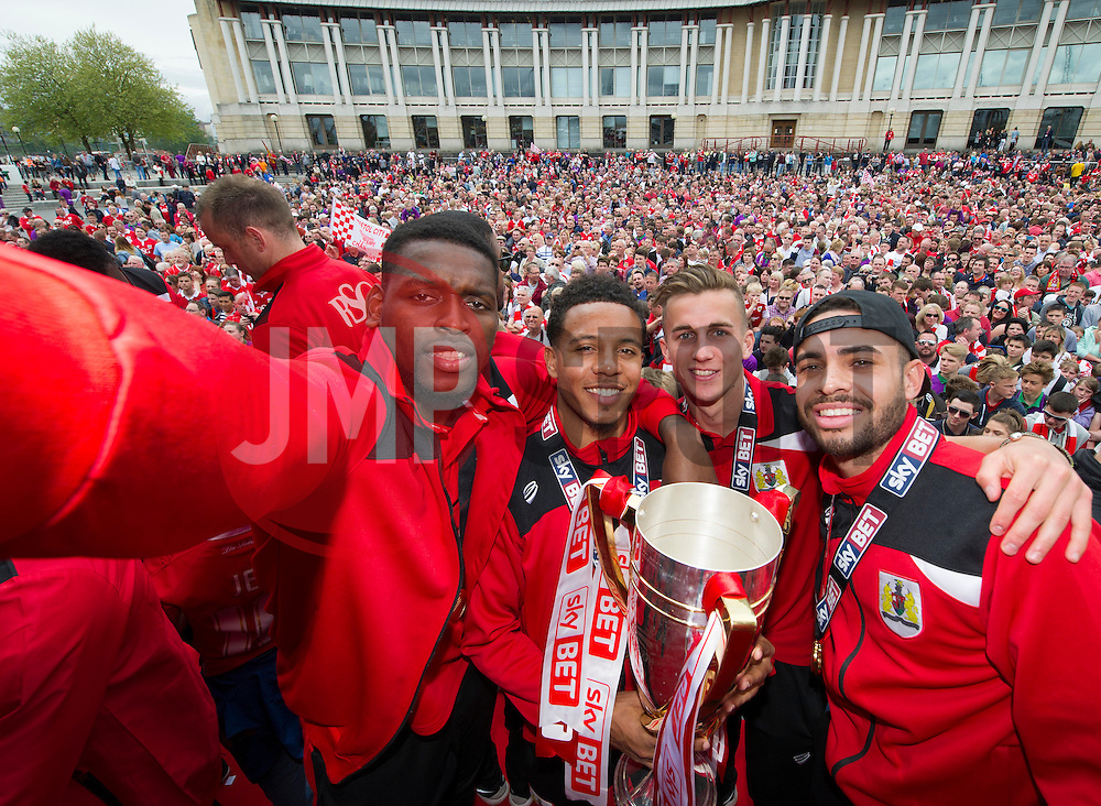 Bristol City's Jay Emmanuel-Thomas takes a selfie of himself, Bristol City's Korey Smith, Bristol City's Joe Bryan and Bristol City's Derrick Williams  in front of the thousands of fans gathered at the amphitheatre in Bristol  - Photo mandatory by-line: Joe Meredith/JMP - Mobile: 07966 386802 - 04/05/2015 - SPORT - Football - Bristol -  - Bristol City Celebration Tour