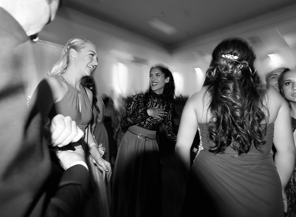 Ariel Zavala, center, shares a laugh with friends while at Alonso High School's prom Saturday, April 30, 2016 in Tampa. CHRIS URSO/STAFF