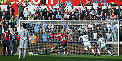 SWANSEA, WALES - Sunday, March 11, 2012: Manchester City's goalkeeper Joe Hart saves a penalty from Swansea City's Scott Sinclair during the Premiership match at the Liberty Stadium. (Pic by David Rawcliffe/Propaganda)