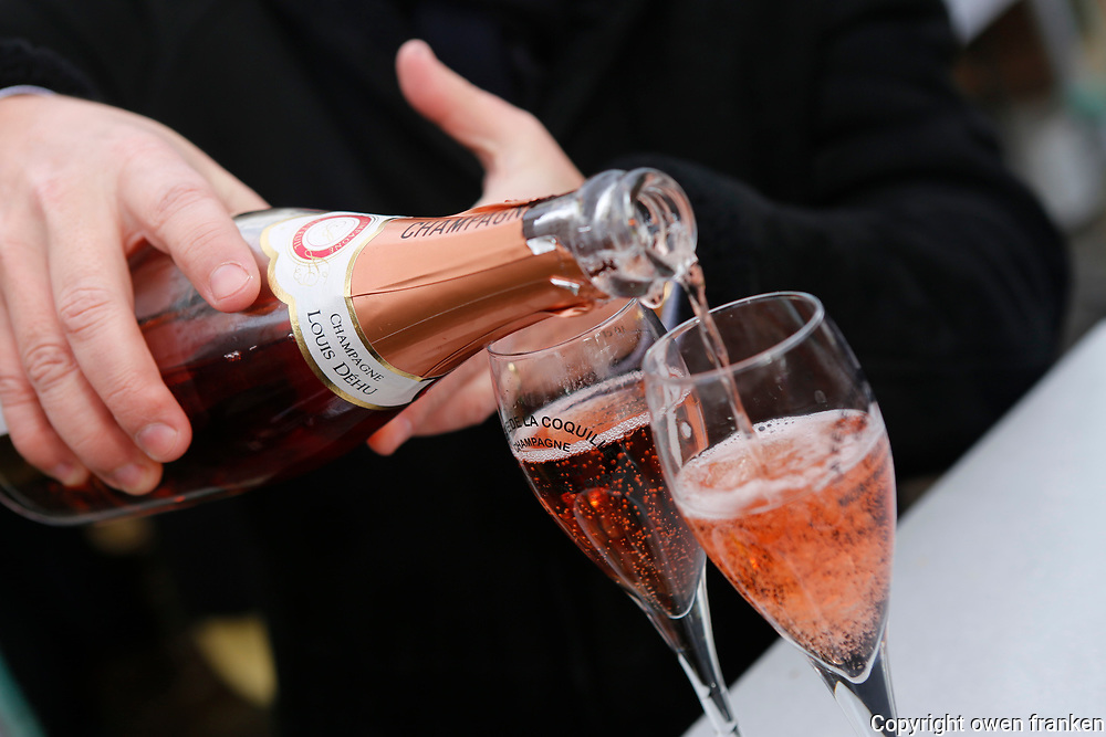 pouring Champagne at a food festival, Paris