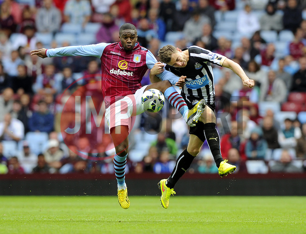 Aston Villa's Charle N'Zogbia battles for the ball with Newcastle United's Paul Dummett - Photo mandatory by-line: Joe Meredith/JMP - Mobile: 07966 386802 23/08/2014 - SPORT - FOOTBALL - Birmingham - Villa Park - Aston Villa v Newcastle United - Barclays Premier League