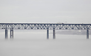 Newburgh, New York -  Fog covers the Hudson River as traffic crosses the Newburgh-Beacon bridge on a warm winter day, Jan. 2, 2010.