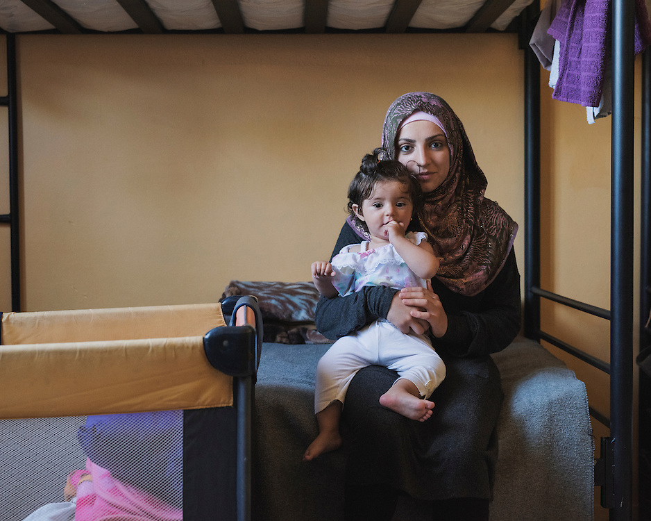 Najah from Syria with her 11 month infant daughter Amenah in their room in PIKPA, a refuge opened in January 2016 by the Leros Solidarity Network as a shelter for families and unaccompanied minors. Amenah was born the day after her father fled to Germany, so she has never seen him.