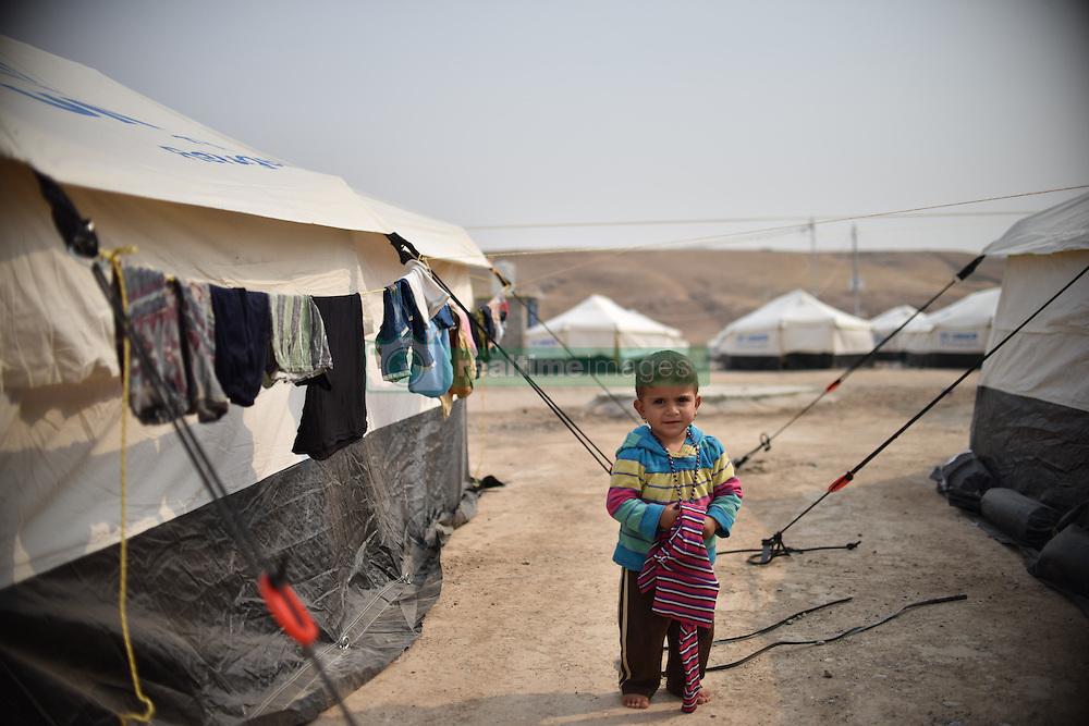 A young girl in the refugees camp of UNHCR in Zelican, North of Mosul, Kurdistan Region of Iraq on October 25, 2016. UNHCR is stepping up its preparations to receive those displaced by the fighting to retake Iraqís second city, Mosul. Photo by Mathieu Redoube/ABACAPRESS.COM