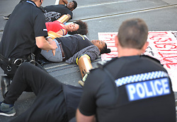 Police officers talk with protesters in Nottingham city centre after activists blocked the tram tracks near Nottingham Theatre Royal to protest for social justice movement Black Lives Matter.