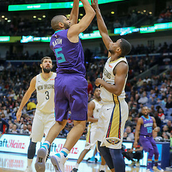 Mar 13, 2018; New Orleans, LA, USA; Charlotte Hornets guard Nicolas Batum (5) shoots over New Orleans Pelicans forward Darius Miller (21) during the first quarter of a game at the Smoothie King Center. Mandatory Credit: Derick E. Hingle-USA TODAY Sports