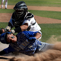 Northview catcher Jose Urbina (30) tags out San Dimas' Jessie Garcia at home plate in the second inning of a prep baseball game at Northview High School in Covina, Calif., Thursday, April 16, 2015. San Dimas won 5-0.