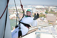 140518 ISON Doris Long Abseil <br /> Intrepid centenarian Doris Long MBE waves before abseiling down the 130 metre tall Spinnaker Tower in Portsmouth today, on her 100th Birthday. She performed the feat to raise funds for local charity, The Rowans Hospice and it is her 15th abseil. Daring Doris took up abseiling at 85 and today broke her own record of being the oldest person to abseil. Picture date Sunday 18th May, 2014.<br /> Picture by Christopher Ison. Contact +447544 044177 chris@christopherison.com