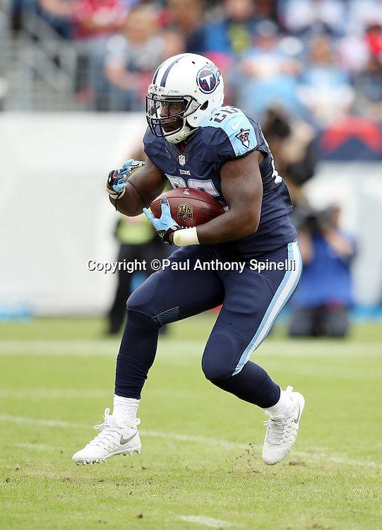 Tennessee Titans rookie running back Antonio Andrews (26) runs for a first quarter first down during the 2015 week 7 regular season NFL football game against the Atlanta Falcons on Sunday, Oct. 25, 2015 in Nashville, Tenn. The Falcons won the game 10-7. (©Paul Anthony Spinelli)
