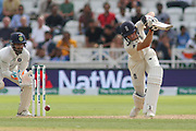 Jos Butler of England cover drives on his way to 100 during the 3rd International Test Match 2018 match between England and India at Trent Bridge, West Bridgford, United Kingdon on 21 August 2018.