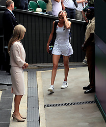 Magdalena Rybarikova leaves court after losing to Garbine Muguruza on day ten of the Wimbledon Championships at The All England Lawn Tennis and Croquet Club, Wimbledon.