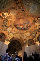 Beautiful painted ceilings in The Louvre Museum, Paris, France.