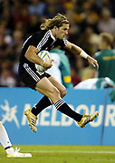 New Zealand's Cory Jane attacks during the rugby sevens match against Kenya at the Telstra Dome on day one of the XVIII Commonwealth Games in Melbourne, Australia, on Thursday 16 March 2006. Photo: Sport the Library / www.photosport.nz