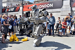 © Licensed to London News Pictures. 12/07/2017. London, UK. An robot entertains the audience.  Formula One racing comes to Trafalgar Square and Whitehall for a promotional event called F1LiveLondon ahead of the British Grand Prix at Silverstone. Photo credit : Stephen Chung/LNP