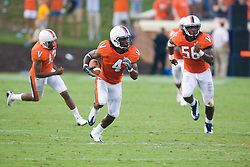 Virginia cornerback Vic Hall (4) returns an interception 60 yards for a touchdown. The Virginia Cavaliers defeated the Richmond Spiders 16-0 in a NCAA football game held at Scott Stadium on the Grounds of the University of Virginia in Charlottesville, VA on September 6, 2008.