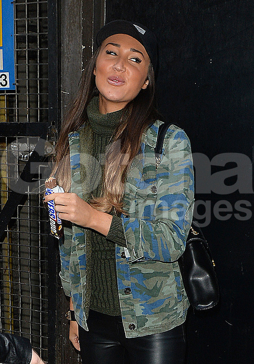 Megan McKenna enjoys a Snickers bar after attending a meeting in London, UK. 28/01/2016<br />