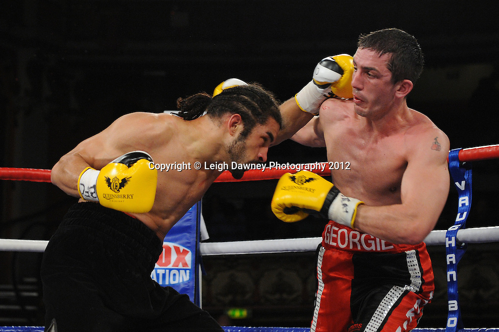 Jason Ball (black shorts) defeats Steve Harkin in a 10x3 min Light Middleweight contest at Olympia, Liverpool on the 20th January 2012. Vaughan Boxing Promotions. © Leigh Dawney Photography 2012.