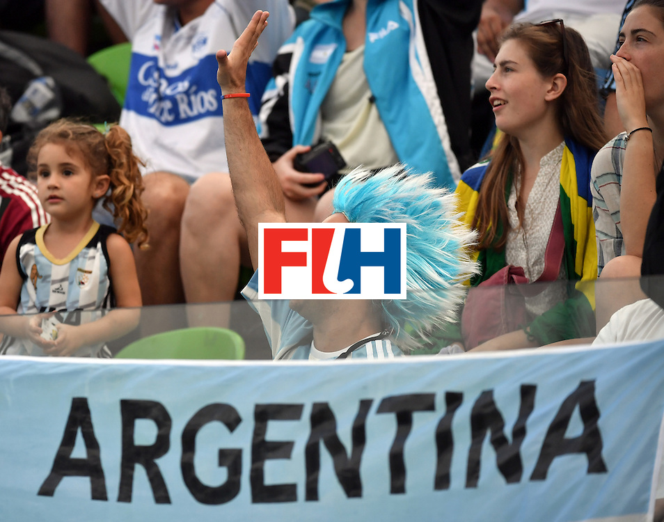 An Argentina fan cheers his team during the men's Gold medal field hockey Belgium vs Argentina match of the Rio 2016 Olympics Games at the Olympic Hockey Centre in Rio de Janeiro on August 18, 2016. / AFP / Pascal GUYOT        (Photo credit should read PASCAL GUYOT/AFP/Getty Images)
