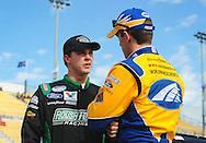 Nov. 12 2011; Avondale, AZ, USA; NASCAR Nationwide Series driver Trevor Bayne (13) talks with Carl Edwards (60) during qualifying for the Wypall 200 at Phoenix International Raceway. Mandatory Credit: Jennifer Stewart-US PRESSWIRE