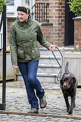 A woman takes a chocolate labrador for a walk from the Chiswick, West London former home of Ant McPartlin, where Lisa McPartlin (Lisa Armstrong) his estranged wife lives. Ant of TV duo Ant and Dec was arrested on March 18th 2018 on suspicion of drink-driving  following a road accident in Richmond, in which a young girl was hospitalised. London, March 19 2018.