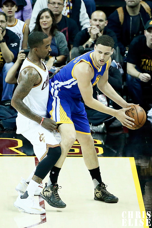 07 June 2017: Cleveland Cavaliers guard Kyrie Irving (2) defends on Golden State Warriors guard Klay Thompson (11) during the Golden State Warriors 118-113 victory over the Cleveland Cavaliers, in game 3 of the 2017 NBA Finals, at  the Quicken Loans Arena, Cleveland, Ohio, USA.