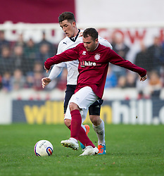 Raith Rovers Ross Perry and Linlithgow Rose Colin Strickland.<br /> Linlithgow Rose 0 v 2 Raith Rovers, William Hill Scottish Cup Third Round game player today at Prestonfield.
