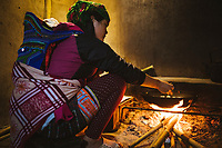 Homestay owner Su prepares dinner for her guests at her home in Giang Ta Chai village in northern Vietnam.