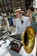 Michael Cumella winds one of the antique record players that played old 78s between orchestra sets. Cumella hosts a radio program featuring antique disc and cylinder records.