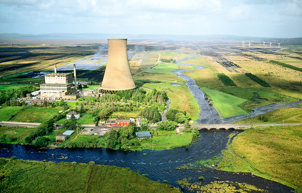 Bellacorick peat turf fired power station and wind turbines at the centre of the vast peat bog of west County Mayo, Ireland.