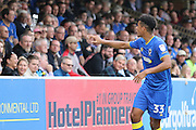 AFC Wimbledon striker Lyle Taylor (33) throws the water back to the fan during the EFL Sky Bet League 1 match between AFC Wimbledon and Shrewsbury Town at the Cherry Red Records Stadium, Kingston, England on 24 September 2016. Photo by Stuart Butcher.