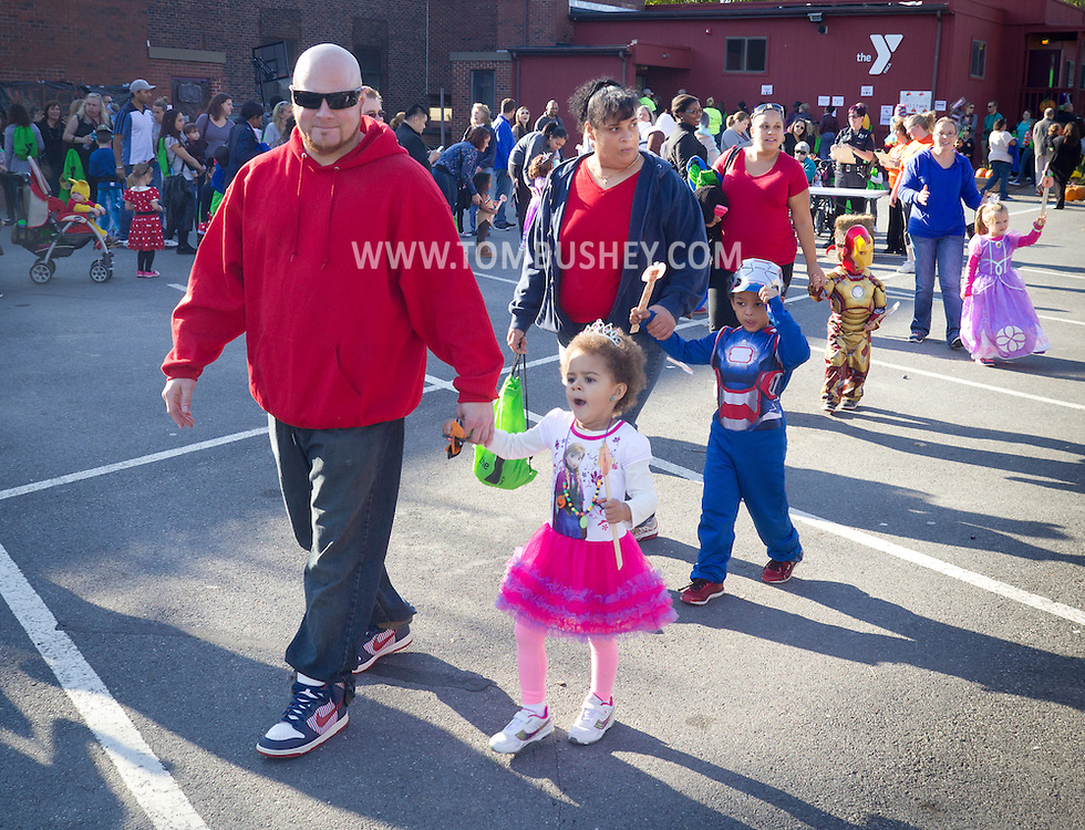 Middletown, New York  - Children enjoy the Halloween Fall Festival at the Middletown YMCA's Center for Youth Programs on Oct. 25, 2014.