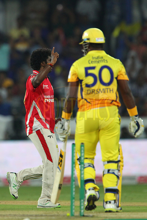 Parvinder AWANA  of the Kings XI Punjab celebrates the wicket of /Dwayne SMITH of the Chennai Superkings  during the second semi final match of the Oppo Champions League Twenty20 between the Kings XI Punjab and the Chennai Superkings held at the Rajiv Gandhi Cricket Stadium, Hyderabad, India on the 2nd October 2014<br /> <br /> Photo by:  Ron Gaunt / Sportzpics/ CLT20<br /> <br /> <br /> Image use is subject to the terms and conditions as laid out by the BCCI/ CLT20.  The terms and conditions can be downloaded here:<br /> <br /> http://sportzpics.photoshelter.com/gallery/CLT20-Image-Terms-and-Conditions-2014/G0000IfNJn535VPU/C0000QhhKadWcjYs