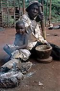 Baka Grandfather and grandchild at a Baka Camp, Mambele.