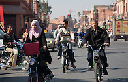 People travel on motor scooters in the medina of Marrakech, Morocco. Photo for editorial use.