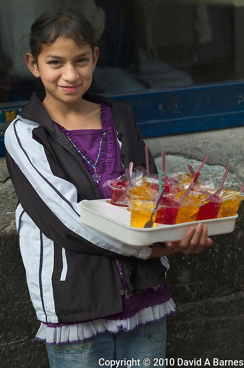 Young girl vending jello on street, Quito, Ecuador