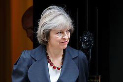 © Licensed to London News Pictures. 22/11/2016. London, UK. Prime Minister THERESA MAY leaves No10 to welcome Belgium Prime Minister Charles Michel in Downing Street on Tuesday, 22 November 2016. Photo credit: Tolga Akmen/LNP