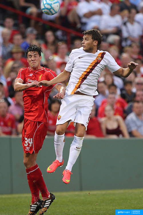 Martin Kelly, (left), Liverpool, and Adem Ljajić, AS Roma, challenge for the ball during the Liverpool Vs AS Roma friendly pre season football match at Fenway Park, Boston. USA. 23rd July 2014. Photo Tim Clayton