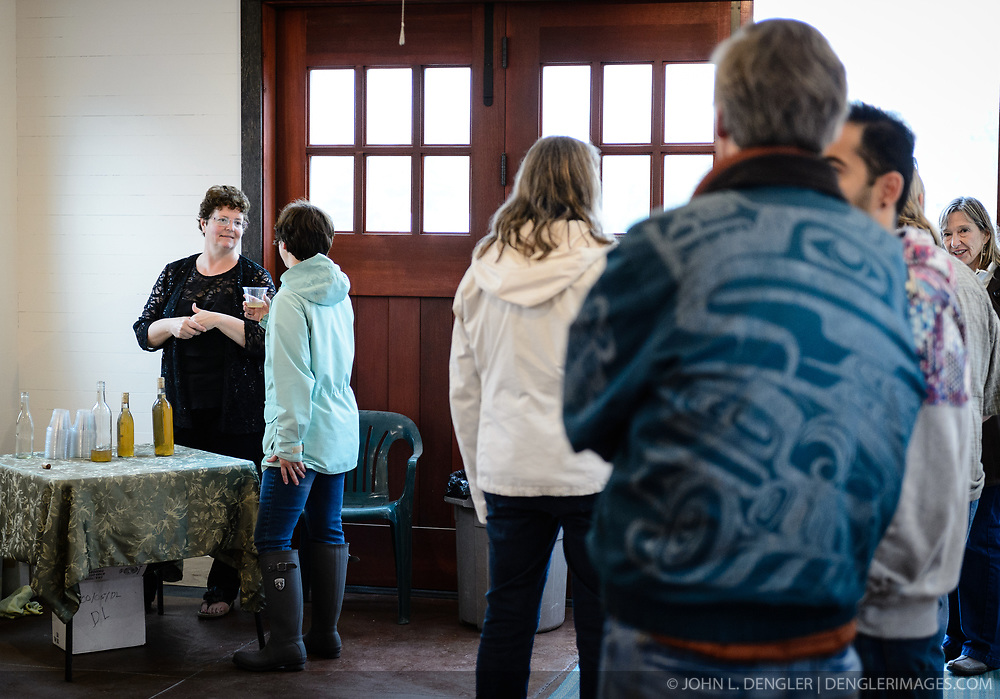 Phyllis Sage (left) speaks with Christine Baskaya of Haines during a recent open house to celebrate the completion of the restoration of the fire hall located on the grounds of historic Fort William H. Seward, located in Haines, Alaska.<br /> <br /> The fire hall was restored over a two-year period by owners Sage and Joanne Waterman who also own the fort&rsquo;s original guardhouse, now a bed and breakfast, located next door to the fire hall.<br /> <br /> After being absent from the historic Fort Seward skyline since approximately the 1930s, the 60-foot tower of the fort&rsquo;s fire hall has been restored to its original height. The building and tower, built around 1904 in Haines, Alaska, was shortened to approximately half its height in the 1930s for unknown reasons. The restoration included rebuilding a missing 35-foot section of the 60-foot tower whose purpose was to dry fire hoses. The tower restoration was completed by building its four sections on the ground and then hoisting those sections with a crane into place on top of each other.<br /> <br /> Through the years, the historic Fort Seward area, a former U.S. Army post, has been referred to as Fort William H. Seward, Chilkoot Barracks, and Port Chilkoot. The National Historic Landmarks listing record for the fort says that &quot;Fort Seward was the last of 11 military posts established in Alaska during the territory's gold rushes between 1897 and 1904. Founded for the purpose of preserving law and order among the gold seekers, the fort also provided a U.S. military presence in Alaska during boundary disputes with Canada. The only active military post in Alaska between 1925 and 1940, the fort was closed at the end of World War II.&rdquo; <br /> <br /> The bottom portion of the fire hall is being leased as commercial space. Due to fire code restrictions there is no public access to the upper portion of the tower.