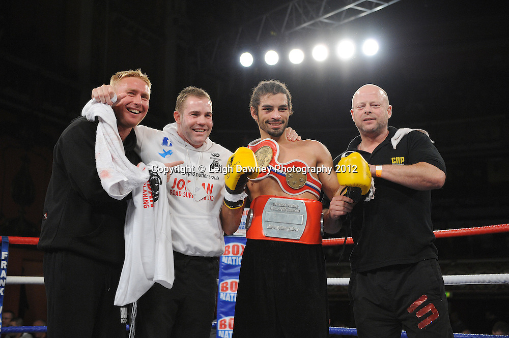 Jason Ball with team celebrates after defeating Steve Harkin in a 10x3 min Light Middleweight contest at Olympia, Liverpool on the 20th January 2012. Vaughan Boxing Promotions. © Leigh Dawney Photography 2012.