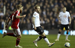 Derby County's Johnny Russell passes past Middlesbrough's Adam Clayton - Photo mandatory by-line: Robbie Stephenson/JMP - Mobile: 07966 386802 - 17/03/2015 - SPORT - Football - Derby - iPro Stadium - Derby County v Middlesbrough - Sky Bet Championship