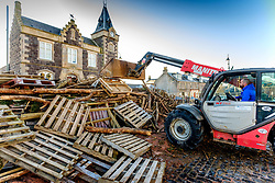 Building the hogmanay bonfire in Biggar on Sunday 10th December.  Work starts on 1st December and continues throughout the month.  By hogmanay it will be the size of a two storey house and will be lit this year by Biggar resident Mrs Dorothy Frame at 9.30pm on hogmanay.<br /> <br /> (c) Andrew Wilson | Edinburgh Elite media