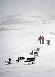 © Licensed to London News Pictures. 05/02/2012. Dunstable, UK. A man and woman walk across a snow covered Dunstable Downs in Bedfordshire,  on February 5th, 2012. Photo credit : Ben Cawthra/LNP