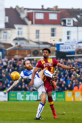 Stuart Sinclair of Bristol Rovers and Alex Laird of Bradford City compete for the ball - Rogan/JMP - 20/01/2018 - FOOTBALL - Memorial Stadium - Bristol, England - Bristol Rovers v Bradford City - EFL Sky Bet League One.