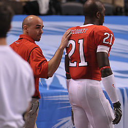 Dec 19, 2009; St. Petersburg, Fla., USA; Rutgers cornerback Devin Mccourty (21) leaves the field after sustaining an eye injury during NCAA Football action in Rutgers' 45-24 victory over Central Florida in the St. Petersburg Bowl at Tropicana Field.