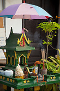 Luang Prabang, Laos. A spirit house for Buddhist offerings at a stall in the morning food market.