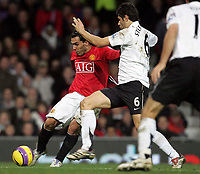 Photo: Paul Thomas/Sportsbeat Images.<br /> Manchester United v Fulham. The FA Barclays Premiership. 03/12/2007.<br /> <br /> Carlos Tevez (L) of Utd shoots past Dejan Stefanovic.