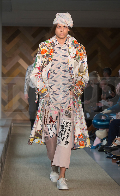 © Licensed to London News Pictures. 29/05/2014. London, England. Collection by Faye Oakenfull. 30 students of the Royal College of Art's prestigious MA Fashion programme presented their final collections in  a runway show at the RCA building in Kensington. Photo credit: Bettina Strenske/LNP