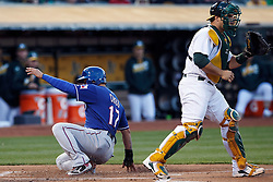 OAKLAND, CA - JUNE 14:  Shin-Soo Choo #17 of the Texas Rangers scores a run past Josh Phegley #19 of the Oakland Athletics during the first inning at the Oakland Coliseum on June 14, 2016 in Oakland, California. (Photo by Jason O. Watson/Getty Images) *** Local Caption *** Shin-Soo Choo; Josh Phegley