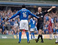 Photo. Glyn Thomas, Digitalsport<br /> Birmingham City v Aston Villa <br /> Barclays Premiership. 20/03/2005.<br /> Birmingham's Emile Heskey (L) disputes a decision with referee Mike Riley
